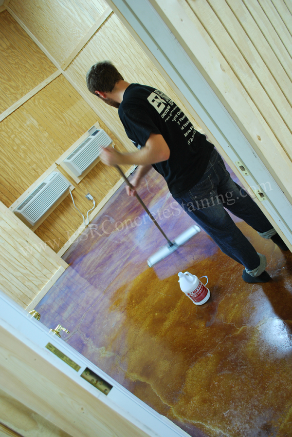 Applying A Protective Coating Of Wax To This Decorative Concrete Floor