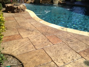 Stamped concrete overlay pool deck